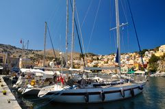 Boats moored on the island of Symi Stock Images
