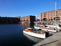 Boats moored at Liverpool Albert Docks in Summer royalty free stock image