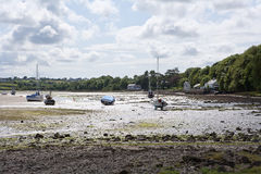 Boats moored at low tide. Boats moored at low tide, Anglesey, Wales stock images