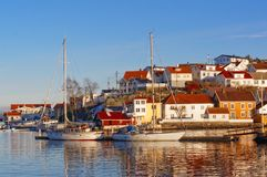 Boats moored with lowered sails on the fjord Royalty Free Stock Photos