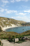 Boats moored in Lulworth Cove Royalty Free Stock Photos