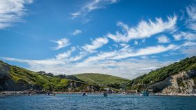 Boats moored at Lulworth Cove on Dorset coast royalty free stock images