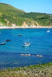 Boats moored at Lulworth Cove. Stock Photos