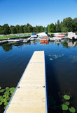 Boats moored in marina. On lake Royalty Free Stock Image