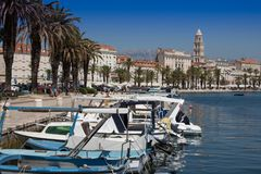Boats moored in the marina. Boats moored in the marina in Split - Croatia. Old town and Doclecian Palace in the distance Royalty Free Stock Photos