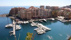 Boats moored in marina in Fontvieille quarter or district of Principality of Monaco. stock footage
