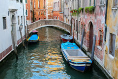 Boats moored in a narrow canal in Venice, Italy Royalty Free Stock Images