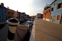 Boats moored in the navigable canal of Burano island near Venice. In Northern Italy Royalty Free Stock Image