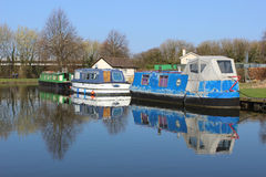 Boats moored at northern end of Lancaster canal. Stock Photos