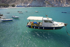 Boats moored off Greek beach stock images