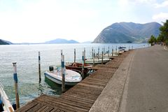 Boats moored in Peschiera Maraglio with Lake Iseo on the background, Monte Isola, Italy.  stock photos