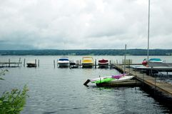 Boats moored by pier on lake Royalty Free Stock Images
