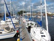 Boats moored at Porthmadog harbor. Stock Photos