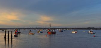 The River Deben at Felixstowe Ferry in the twilight. Boats moored in the River Deben at Felixstowe Ferry in the twilight Stock Photo