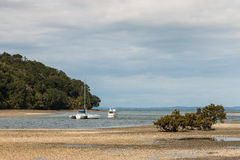 Boats moored in river estuary Royalty Free Stock Photography