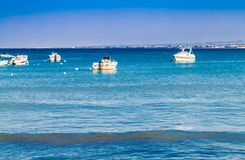Boats moored at seaside Stock Photography