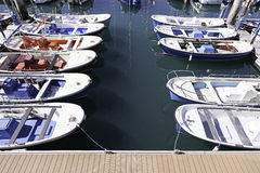 Boats moored on a seaside pier Royalty Free Stock Photo
