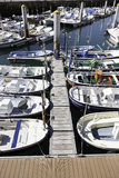 Boats moored on a seaside pier Stock Photos
