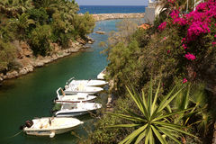 Boats moored in Sissi Bay in Crete Royalty Free Stock Photo