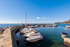 Boats moored in a small harbor in the Gulf of Trieste. royalty free stock photography