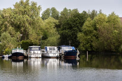 Boats moored in a small harbor Royalty Free Stock Photography