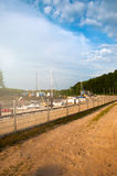 Boats moored at a small port stock photo
