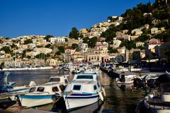Boats moored in Symi Island harbour Greece Stock Photos