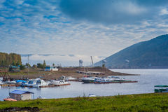 Boats moored to the bank of yenisei river in Siberia. Russia Royalty Free Stock Photography
