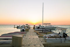 Boats moored to pier at sundown Royalty Free Stock Image