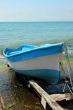 Boats moored to the shore Royalty Free Stock Photos