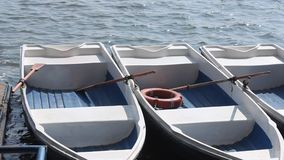 Boats moored to the shore stock video footage