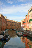 Boats moored on Venice canal Stock Images