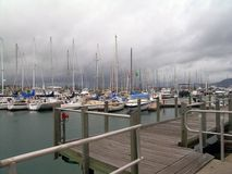 Boats at Mooring. Storm coming in over moored boats royalty free stock photos