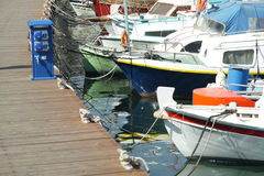 Boats at mooring line. Different boats at mooring line in Rhodes creek Stock Photo