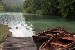Boats mooring at pier Stock Photography