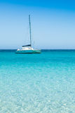 Boats mooring in the turquoise water of  Rondinara beach in Cors Royalty Free Stock Images