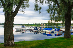 Boats in Mora. Trees an Boats in Mora, Sweden Stock Photos