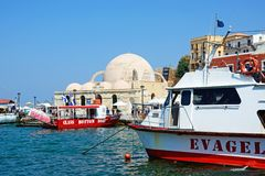 Boats and mosque, Chania. Royalty Free Stock Photo