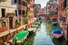 Boats and motorboats on a canal in Venice Royalty Free Stock Image