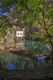 Boats and mountain by the dam at Matka Canyon Stock Image
