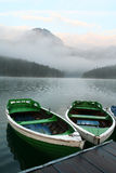 Boats on mountain lake Stock Photography