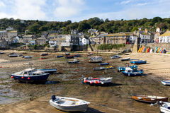 Boats in Mousehole harbour Cornwall England at low tide Stock Photography
