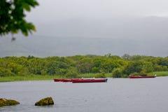 Boats on Muckross Lake near Killarney, County Kerry. Red fishing boats on Muckross Lake, near Killarney, west of Ireland Royalty Free Stock Photography
