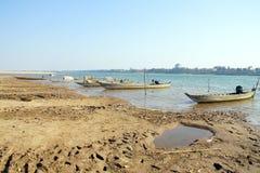 Boats on mud flats of  Mekong Stock Photography