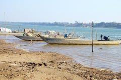 Boats on mud flats of  Mekong Royalty Free Stock Image