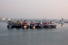 Boats in Mumbai harbour. A group of passenger boats moored in the harbour in the Colaba district of Mumbai, India Royalty Free Stock Photo