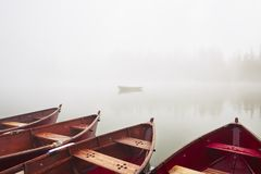 Boats in mysterious fog. Boats on the lake at morning fog Stock Images