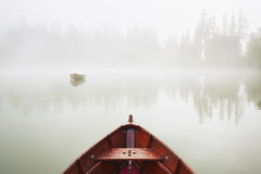 Boats in mysterious fog Stock Images