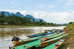 Boats in Nam Song river. At Vang Vieng, Laos Stock Photo