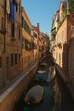 Boats on narrow canal Royalty Free Stock Photography